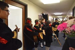 "WLI Students observe ""El Dia de la Madre"" with music and flowers"