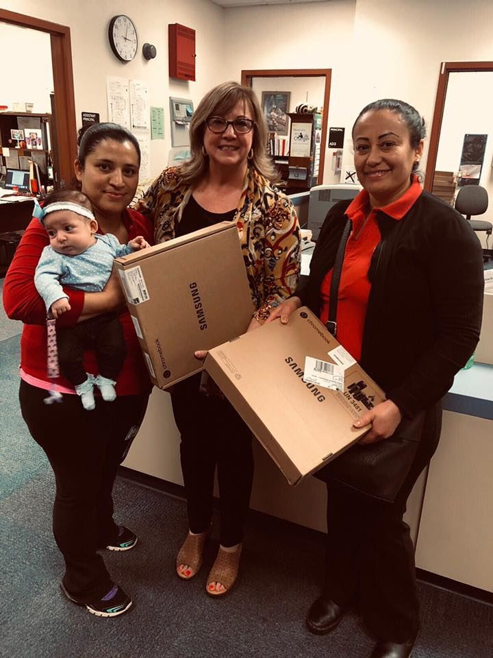 PU Parents receive laptops for Perfect Attendance